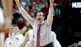 FILE - In this Nov. 26, 2017, file photo, Nebraska coach Tim Miles calls a play during the second half of an NCAA college basketball game against Boston College, in Lincoln, Neb. A person familiar with the situation tells The Associated Press that Nebraska basketball coach Tim Miles is receiving a one-year contract extension. The person spoke on condition of anonymity because the school hasn't officially announced Miles' extension. (AP Photo/Nati Harnik, File)