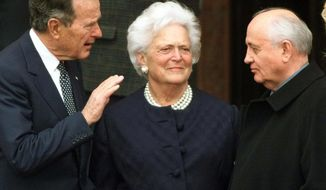 FILE - In this Nov. 8, 1999, file photo, former U.S. President George H.W. Bush, left, chats with former Soviet leader Mikhail Gorbachev, right, as Barbara Bush looks on before Bush was awarded the honorary citizenship of Berlin. A family spokesman said Tuesday, April 17, 2018, that former first lady Barbara Bush has died at the age of 92. (AP Photo/Herbert Knosowski, File)