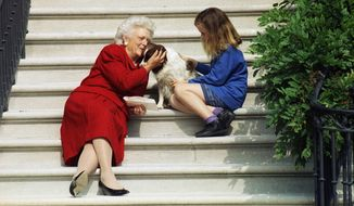 In this Sept. 13, 1991, file photo, then-first lady Barbara Bush, her granddaughter Barbara, and Millie wait on the steps of the White House for U.S. President George H.W. Bush to return from his check-up at Bethesda Naval Hospital in Washington. A family spokesman said Tuesday, April 17, 2018, that former first lady Barbara Bush has died at the age of 92. (AP Photo/Barry Thumma, File )