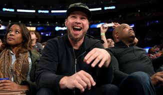 FILE - In this Nov. 6, 2016 file photo, Pearl Jam bassist Jeff Ament reacts as he is introduced during an NBA basketball game between the New York Knicks and the Utah Jazz in New York. One of the four cities in Pearl Jam's North American tour this summer will be tiny Missoula, Mont., Ament's part-time home. The pioneering grunge rock band plays the venue each time Ament's hometown friend, U.S. Sen. Jon Tester, is up for election, and this time the band plans to give some of the proceeds of the show to four groups that support youth and Native American voting, land conservation and women's health. (AP Photo/Kathy Kmonicek, File)