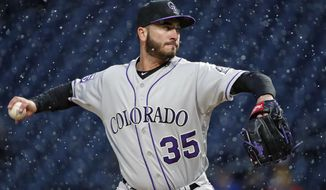 Colorado Rockies starting pitcher Chad Bettis delivers in the first inning of a baseball game against the Pittsburgh Pirates in Pittsburgh, Tuesday, April 17, 2018. (AP Photo/Gene J. Puskar)