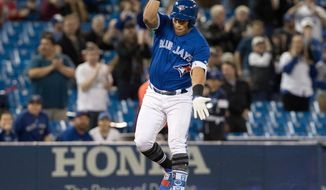 Toronto Blue Jays' Yangervis Solarte celebrates as he rounds third after hitting a two-run home run against the Kansas City Royals in the first inning of the first game of a baseball doubleheader in Toronto, Tuesday April 17, 2018. (Fred Thornhill/The Canadian Press via AP)