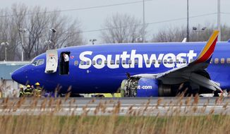 A Southwest Airlines plane sits on the runway at the Philadelphia International Airport after it made an emergency landing in Philadelphia, on Tuesday, April 17, 2018. (David Maialetti /The Philadelphia Inquirer via AP)