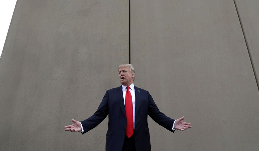 "FILE - In this March 13, 2018 file photo, President Donald Trump speaks during a tour as he reviews border wall prototypes in San Diego. Trump slammed California Gov. Jerry Brown's posture on sending National Guard troops to the Mexican border Tuesday, April 17, 2018, even as Brown said he was nearing agreement on joining the president's mission and that his troops were ""chomping at the bit ready to go."" (AP Photo/Evan Vucci, File)"