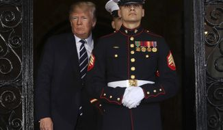 President Donald Trump walks around a pair of Marine Honor Guards, to greet Japanese Prime Minister Shinzo Abe at Trump's private Mar-a-Lago club, Tuesday, April 17, 2018, in Palm Beach, Fla. (AP Photo/Pablo Martinez Monsivais)