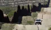 A Customs and Border Patrol agent patrols the international border Tuesday, April 10, 2018 near Nogales, Ariz. The Republican governors of Texas, Arizona and New Mexico on Monday committed 1,600 Guard members to the border, giving President Donald Trump many of the troops he requested to fight what he's called a crisis of migrant crossings and crime. (AP Photo/Matt York)