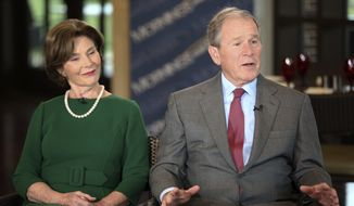 "Former President George W. Bush and Laura Bush are interviewed by host Maria Bartiromo, not pictured, on the ""Mornings with Maria Bartiromo"" program on the Fox Business Network at the George W. Bush Presidential Library, Wednesday, April 18, 2018, in Dallas. Bush spoke about his mother, Barbara Bush, the wife of former President George H.W. Bush, who died Tuesday. (AP Photo/Brandon Wade)"