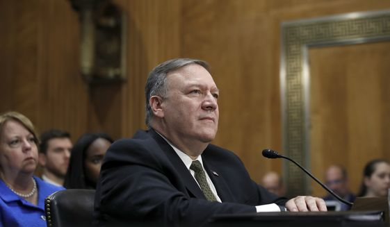 Secretary of State-designate Mike Pompeo pauses while speaking during the Senate Foreign Relations Committee confirmation hearing on his nomination to be Secretary of State, Thursday, April 12, 2018, on Capitol Hill in Washington. (AP Photo/Alex Brandon) ** FILE **
