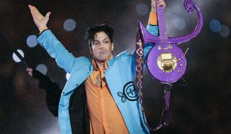 In this Feb. 4, 2007, file photo, Prince performs during halftime of the Super Bowl XLI football game in Miami. Minnesota prosecutors are planning an announcement Thursday, April 19, 2018, in their two-year investigation into Prince's death. Prince was found alone and unresponsive in an elevator at his Paisley Park estate on April 21, 2016. An autopsy found he died of an accidental overdose of fentanyl, a synthetic opioid 50 times more powerful than heroin. (AP Photo/Chris O'Meara, File)