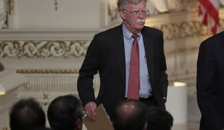 National security adviser John Bolton arrives for a news conference with Japanese Prime Minister Shinzo Abe and President Donald Trump at Trump's private Mar-a-Lago club, Wednesday, April 18, 2018, in Palm Beach, Fla. (AP Photo/Lynne Sladky)