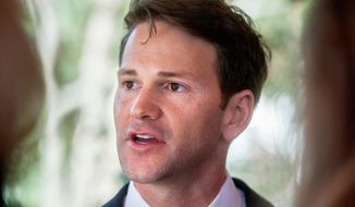 FILE - In this Nov. 10, 2016, file photo, former Illinois U.S. Rep. Aaron Schock talks to reporters in Peoria Heights, Ill. A federal appeals court in Chicago will hear oral arguments Wednesday, April 18, 2018, in Schock's corruption case as his lawyers seek to have all his charges dismissed. The hearing at the 7th U.S. Circuit Court of Appeals comes amid signs parts of the case against the Peoria Republican may be at risk of unraveling. He was indicted in 2016 for misusing government and campaign funds. He'd resigned in 2015. (Matt Dayhoff/Journal Star via AP)