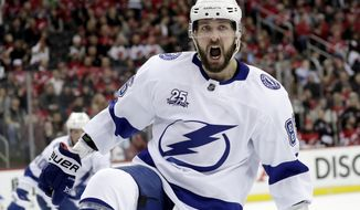 Tampa Bay Lightning right wing Nikita Kucherov, of Russia, celebrates his goal against the New Jersey Devils during the first period of Game 4 of an NHL first-round hockey playoff series Wednesday, April 18, 2018, in Newark, N.J. (AP Photo/Julio Cortez)