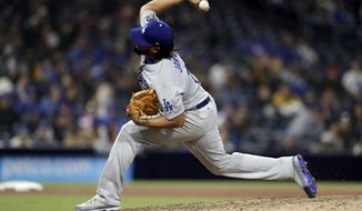 Los Angeles Dodgers relief pitcher Kenley Jansen works against a San Diego Padres batter during the ninth inning of a baseball game Tuesday, April 17, 2018, in San Diego. (AP Photo/Gregory Bull)