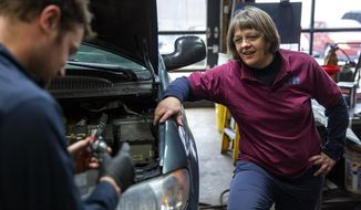 """ADVANCE FOR WEEKEND EDITIONS, APRIL 21-22- In this Tuesday, April 10, 2018 photo, Lift Garage founder Cathy Heying discusses a problem with technician Joel Epstein inside the shop in Minneapolis. After a career in ministry and social work, Heying went to back to school to become a mechanic. """"I walked into the classroom and was confident,"""" Heying said, I have a masters, I've done this before. I got my butt kicked.""""  (Evan Frost/Minnesota Public Radio via AP)"""