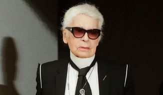 """FILE - in this Dec. 6, 2017 file photo, fashion designer Karl Lagerfeld walks over the stage at Chanel's pre-fall Metiers d'Art fashion show in the new Elbphilharmonie concert house in Hamburg, northern Germany. The oft-outspoken designer drew the ire of the Model Alliance on Tuesday, April 17, 2018, over published remarks on a French fashion site referring to models as """"stupid,"""" """"toxic"""" and """"sordid creatures."""" Sara Ziff, founder of the New York-based organization to protect the rights of models, said the recent comments published by Numero.com were not surprising coming from Lagerfeld but the sentiment, thanks to the #MeToo and Time's Up movements, """"carry the day no longer.""""(AP Photo/Markus Schreiber, File)"""