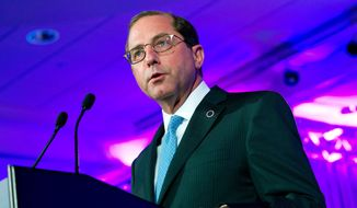 FILE - In this Feb. 24, 2018, file photo, Department of Health and Human Services Secretary Alex Azar speaks at the National Governor Association 2018 winter meeting in Washington. A spokeswoman said Azar is back in the hospital for additional treatment and observation. He's been diagnosed with a painful bowel condition called diverticulitis. (AP Photo/Jose Luis Magana, File)