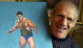 "FILE - In this Nov. 30, 2000, file photo, former pro wrestler Bruno Sammartino, 65, poses with a painting of him in his pro wrestling prime weighing 275 pounds in 1965 at age 35, in his Pittsburgh home. Bruno Sammartino, professional wrestling's ""Living Legend"" and one of its longest-reigning champions, has died. Sammartino was 82. Family friend and former wrestling announcer Christoper Crusie saids Sammartino died Wednesday morning, April 18, 2018, and had been hospitalized for two months. (AP Photo/Gene J. Puskar, File)"