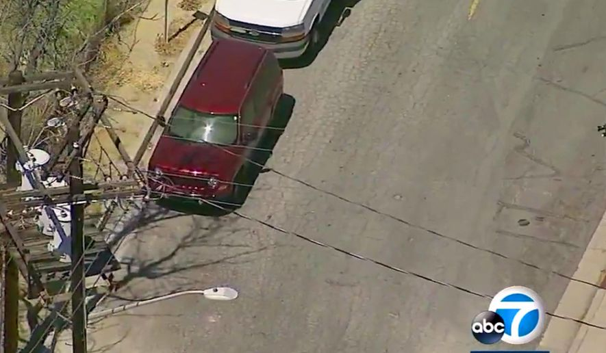This photo from video provided by KABC-TV shows a parked SUV with Tennessee license plates where the bodies of three people were found dead on a street in an industrial area of Burbank, Calif., Tuesday, April 17, 2018. Burbank police Sgt. Derek Green says a parking enforcement officer found the car around 7 a.m. Tuesday. (KABC-TV via AP)