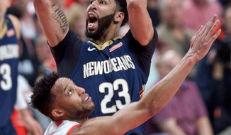 New Orleans Pelicans forward Anthony Davis shoots over Portland Trail Blazers forward Evan Turner during the first half of Game 2 of an NBA basketball first-round playoff series Tuesday, April 17, 2018, in Portland, Ore. (AP Photo/Craig Mitchelldyer)