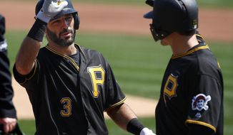 Pittsburgh Pirates' Sean Rodriguez (3) celebrates with David Freese after hitting a two-run home run off Colorado Rockies starting pitcher Kyle Freeland in the fourth inning of a baseball game in Pittsburgh, Wednesday, April 18, 2018. (AP Photo/Gene J. Puskar)