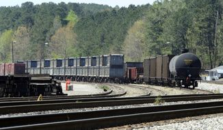 "This April 12, 2018 photo shows containers that were loaded with tons of sewage sludge in Parrish, Ala. More than two months after the so-called ""Poop Train"" rolled in from New York City, Hall says her small town smells like rotting corpses. Some say the trainloads of New Yorkers' excrement is turning Alabama into a dumping ground for other states' waste. (AP Photo/Jay Reeves)"