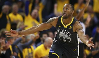 Golden State Warriors' Andre Iguodala celebrates a score against the San Antonio Spurs in the second half in Game 2 of a first-round NBA basketball playoff series, Monday, April 16, 2018, in Oakland, Calif. Golden State won 116-101. (AP Photo/Ben Margot)