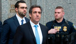 In a Monday, April 16, 2018, file photo, Michael Cohen, President Donald Trump's personal attorney, center, leaves federal court, in New York. (AP Photo/Mary Altaffer, File)
