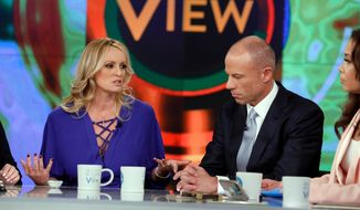 """This image released by ABC shows adult film actress Stormy Daniels, left, with her attorney Michael Avenatti during an appearance on the daytime talk show """"The View,"""" Tuesday, April 17, 2018, in New York. Daniels released a composite sketch Tuesday of the man she says threatened her in a Las Vegas parking lot to stay quiet about her past sexual tryst with President Donald Trump. Avenatti says they are offering $100,000 for information leading to the man's identification. (Heidi Gutman/ABC via AP)"""