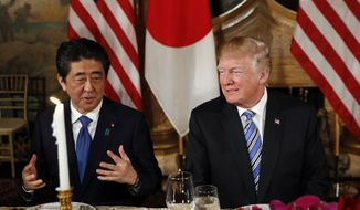 President Donald Trump talks with Japanese Prime Minister Shinzo Abe before dinner at Trump's private Mar-a-Lago club, Wednesday, April 18, 2018, in Palm Beach, Fla. (AP Photo/Pablo Martinez Monsivais)