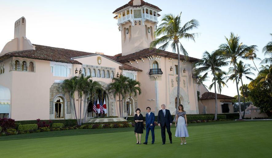 President Donald Trump, first lady Melania Trump, right, Japanese Prime Minister Shinzo Abe and his wife Akie Abe, left, walk at Trump's private Mar-a-Lago club, Tuesday, April 17, 2018, in Palm Beach, Fla. (AP Photo/Pablo Martinez Monsivais)