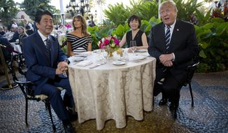 President Donald Trump, first lady Melania Trump, sit with Japanese Prime Minister Shinzo Abe and his wife Akie Abe before dinner Trump's private Mar-a-Lago club, Tuesday, April 17, 2018, in Palm Beach, Fla. (AP Photo/Pablo Martinez Monsivais)