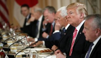 President Donald Trump, second from right, listens during a working lunch with Japanese Prime Minister Shinzo Abe at Trump's private Mar-a-Lago club, Wednesday, April 18, 2018, in Palm Beach, Fla. (AP Photo/Pablo Martinez Monsivais)