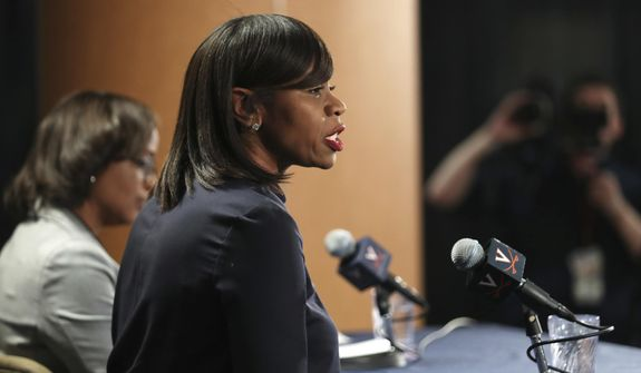 Tina Thompson speaks during a press conference after being introduced as the new women's NCAA college basketball coach at the University of Virginia, at John Paul Jones Arena in Charlottesville, Va., Wednesday, April 18, 2018. At left is Athletic Director Carla Williams. (Zach Wajsgras/The Daily Progress via AP)