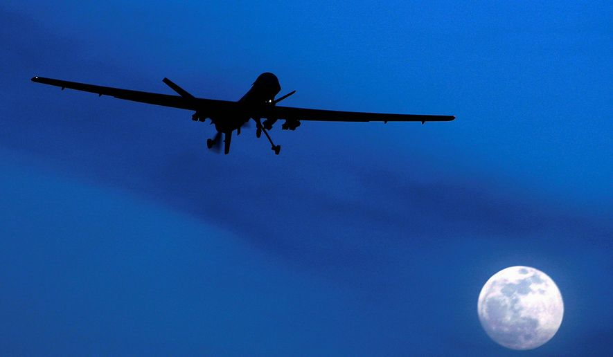 A U.S. Predator drone flies over Kandahar Air Field, southern Afghanistan, on a moon-lit night. (AP Photo/Kirsty Wigglesworth, File)