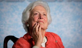 "In this file photo from Friday, March 18, 2005, former first lady Barbara Bush listens to her son, President George W. Bush, as he speaks on Social Security reform in Orlando, Fla. The wife of former President George H.W. Bush is in ""failing health,"" a Bush family spokesman said Sunday, April 15, 2018, following a recent series of hospitalizations and after consulting with her family and doctors, the 92-year-old former first lady has decided not to seek additional medical treatment and will instead focus on comfort care. (AP Photo/J. Scott Applewhite, file)"