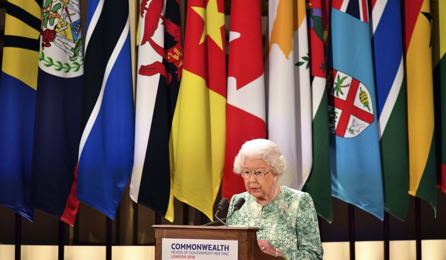 Britain's Queen Elizabeth II speaks during the formal opening of the Commonwealth Heads of Government Meeting in the ballroom at Buckingham Palace in London, Thursday April 19, 2018. (Dominic Lipinski/Pool via AP)