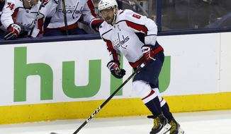 Washington Capitals forward Alex Ovechkin, of Russia, carries the puck against the Columbus Blue Jackets during Game 3 of an NHL first-round hockey playoff series in Columbus, Ohio, Tuesday, April 17, 2018. The Capitals won 3-2 in double overtime. (AP Photo/Paul Vernon)