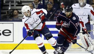 Washington Capitals defenseman Matt Niskanen, left controls the puck against Columbus Blue Jackets forward Nick Foligno during Game 3 of an NHL first-round hockey playoff series in Columbus, Ohio, Tuesday, April 17, 2018. The Capitals won 3-2 in double overtime. (AP Photo/Paul Vernon) **FILE**