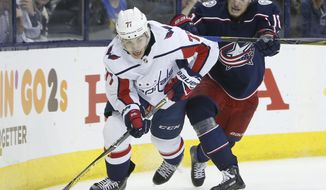 Washington Capitals' T.J. Oshie, left, looks to pass the puck as Columbus Blue Jackets' Pierre-Luc Dubois defends during the third period of Game 4 of an NHL first-round hockey playoff series Thursday, April 19, 2018, in Columbus, Ohio. The Capitals won 4-1. (AP Photo/Jay LaPrete) ** FILE **