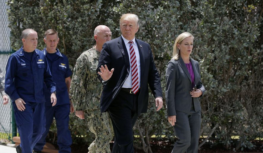 President Donald Trump, center, walks with Homeland Security Secretary Kirstjen Nielsen, right, during his visit to Joint Interagency Task Force South anti-smuggling center in Key West, Fla., (AP Photo/Pablo Martinez Monsivais) ** FILE **