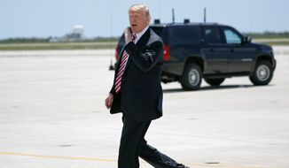 President Donald Trump walks across the tarmac to greet members of the military and their families upon his arrival at Naval Air Station Key West on Air Force One in Key West, Fla., Thursday, April 19, 2018.(AP Photo/Pablo Martinez Monsivais)
