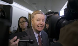 Sen. Lindsey Graham, R-S.C., a member of the Senate Judiciary Committee is questioned by reporters as he arrives for the panel to consider a bipartisan bill he introduced to protect special counsel Robert Mueller's job, on Capitol Hill in Washington, Thursday, April 19, 2018. (AP Photo/J. Scott Applewhite) ** FILE **