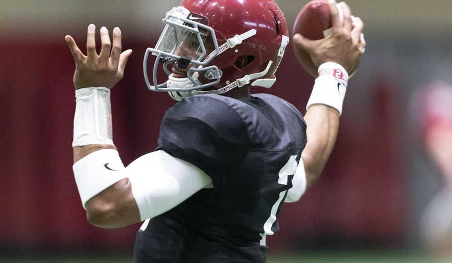 Alabama quarterback Jalen Hurts throws before the NCAA college football team's indoor scrimmage Saturday, April 14, 2018, in Tuscaloosa, Ala. (Vasha Hunt//AL.com via AP)