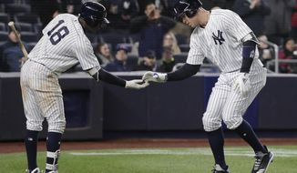 New York Yankees' Aaron Judge is congratulated by Didi Gregorius (18) after hitting a solo home run against the Toronto Blue Jays during the seventh inning of a baseball game Thursday, April 19, 2018, in New York. (AP Photo/Julie Jacobson)