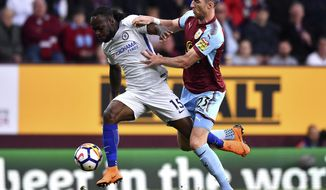Chelsea's Victor Moses, left, and Burnley's Stephen Ward, during the English Premier League soccer match at Turf Moor, in Burnley, England, Thursday April 19, 2018.(Anthony Devlin/PA via AP)