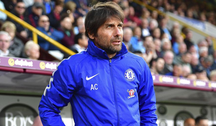 Chelsea manager Antonio Conte looks on at the beginning of play against Burnley, during the English Premier League soccer match at Turf Moor, Burnley, England, Thursday April 19, 2018.(Anthony Devlin/PA via AP)