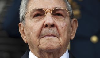 In this March 17, 2015, file photo, Cuba's President Raul Castro listens to the playing of national anthems during his welcome ceremony at the Miraflores presidential palace in Caracas, Venezuela. On April 19, 2018, Raul Castro will step down as president after a decade in office. (AP Photo/Ariana Cubillos, File)