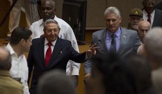 In this photo released by Cuba's state-run media Cubadebate, Cuba's President Raul Castro, center left, enters the National Assembly followed by his successor Miguel Diaz-Canel, center right, for the start of two-day legislative session in Havana, Cuba, Wednesday, April 18, 2018. The Cuban assembly selected the 57-year-old First Vice President as the sole candidate to succeed Castro on Wednesday, in a transition aimed at ensuring that the country's single-party system outlasts the aging revolutionaries who created it. (Irene Perez/Cubadebate via AP)