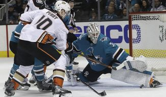 San Jose Sharks goalie Martin Jones, right, defends a shot by Anaheim Ducks right wing Corey Perry (10) during the second period of Game 4 of an NHL hockey first-round playoff series in San Jose, Calif., Wednesday, April 18, 2018. (AP Photo/Jeff Chiu)
