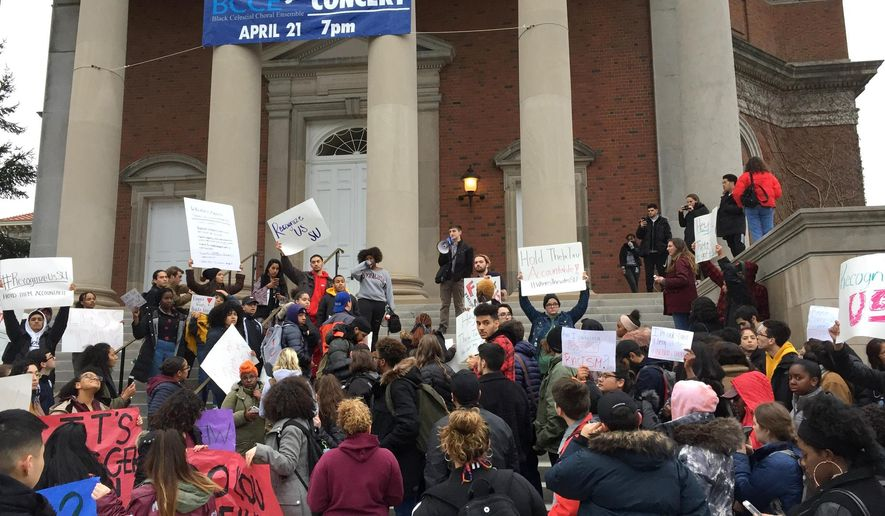 Syracuse University students gather outside Hendricks Chapel on Wednesday, April 18, 2018 to protest a video made by members of a now-suspended fraternity showing racist and sexist behavior in Syracuse, N.Y.   The school's chancellor, Ken Syverud, described the video involving members of Theta Tau, a professional engineering fraternity, as racist, anti-Semitic, homophobic, sexist and hostile to people with disabilities. He said the videos were turned over to the school's Department of Public Safety for possible disciplinary or legal action.   (Lindsey Sabado/The Syracuse Newspapers via AP)